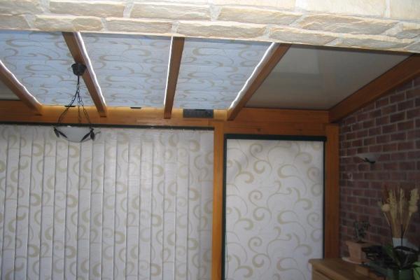 Stores de toiture et fenêtre de véranda